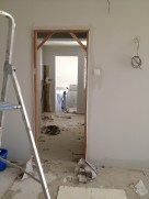 Kitchen entrance. Door frames still not painted
