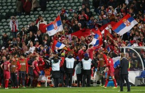 Serbian players celebrate with their supporter's following their win in extra time over Mali during their U20 soccer World Cup semifinal game in Auckland, New Zealand, Wednesday, June 17, 2015. (AP Photo/David Rowland)