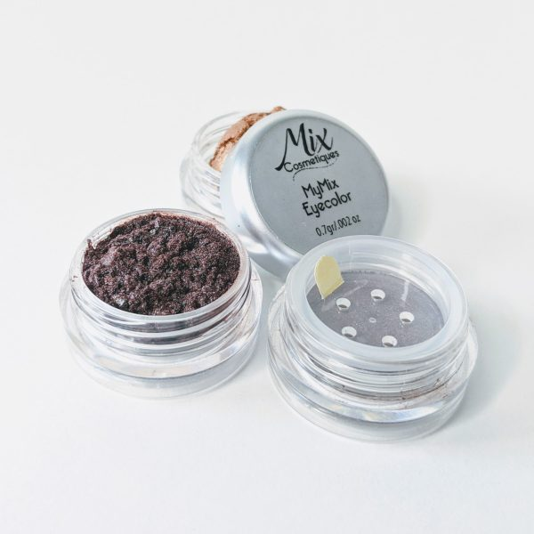 custom eyeshadow in three containers with a copper eyehadow a duo chrome eyeshadow with purple undertones and a neutral eyeshadow on white background