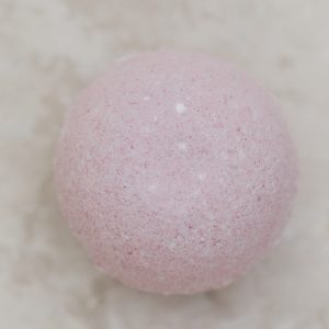 Pink bath bomb with jasmine and grapefruit essential oil and beet juice extract for natural color