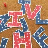red and blue stars on bulletin board letters