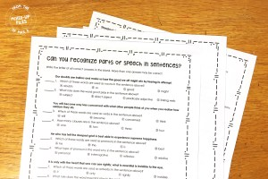 stack of papers with parts of speech quiz