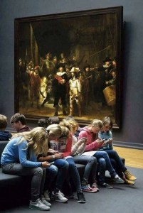 students at museum on phones