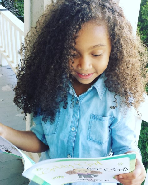 Goldy Girl and her Curls by Nicholette Thomas