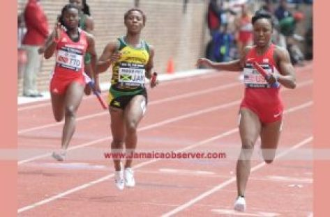 Jamaica's Shelly-Ann Fraser-Pryce (centre) finishes second behind United States' Carmelita Jeter (right) in the 4x100m event at the Penn Relays yesterday.Photo: Collin Reid courtesy of Supreme Ventures, Courts and Team Jamaica Bickle
