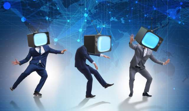 90808966 - media zombie concept with man and tv set instead of head