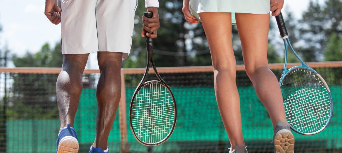 Two Tennis Players Are Standing Before Net Outdoor