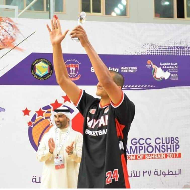 Mizo Amin waving at the fans holding the best 3 point shooter in the gulf region Trophy
