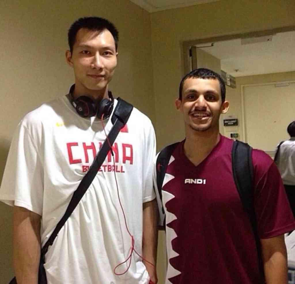 [Mizo Amin with Chinese X-NBA Player Yi Jianlian after the game]