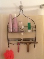 The shower organizer in our bathroom. Note the brass squeegee. Keeping the soap scum from building up in your shower will save time and effort.