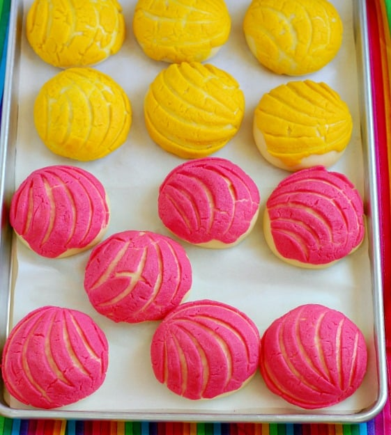Mexican breakfast rolls have a shocking pink or lemon yellow cookie topping are a delicious way to start your day.   mjbakesalot.com