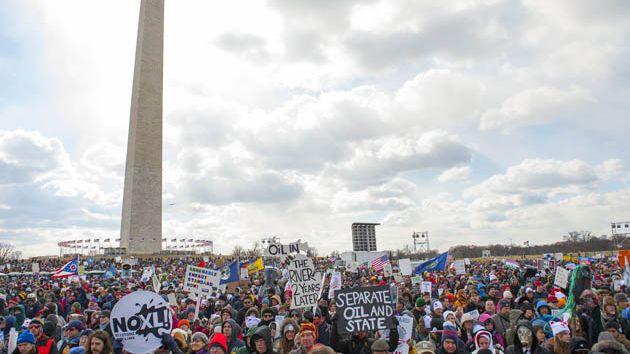 Washington monument with protestors around it