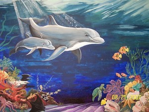 8 X 15 feet mural at Dolphin Bay Elementary School. Dolphins are nearly life-sized.