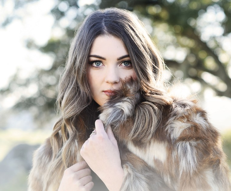 Senior girl with fur coat