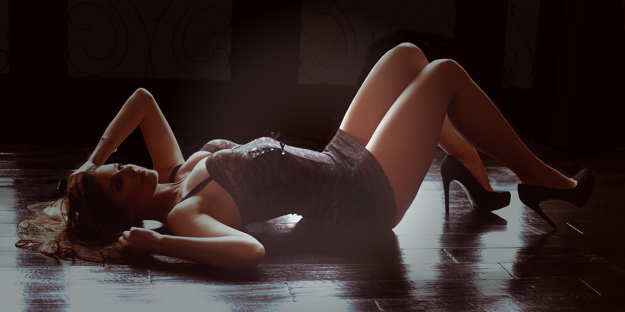 torso of woman laying down in black lingerie