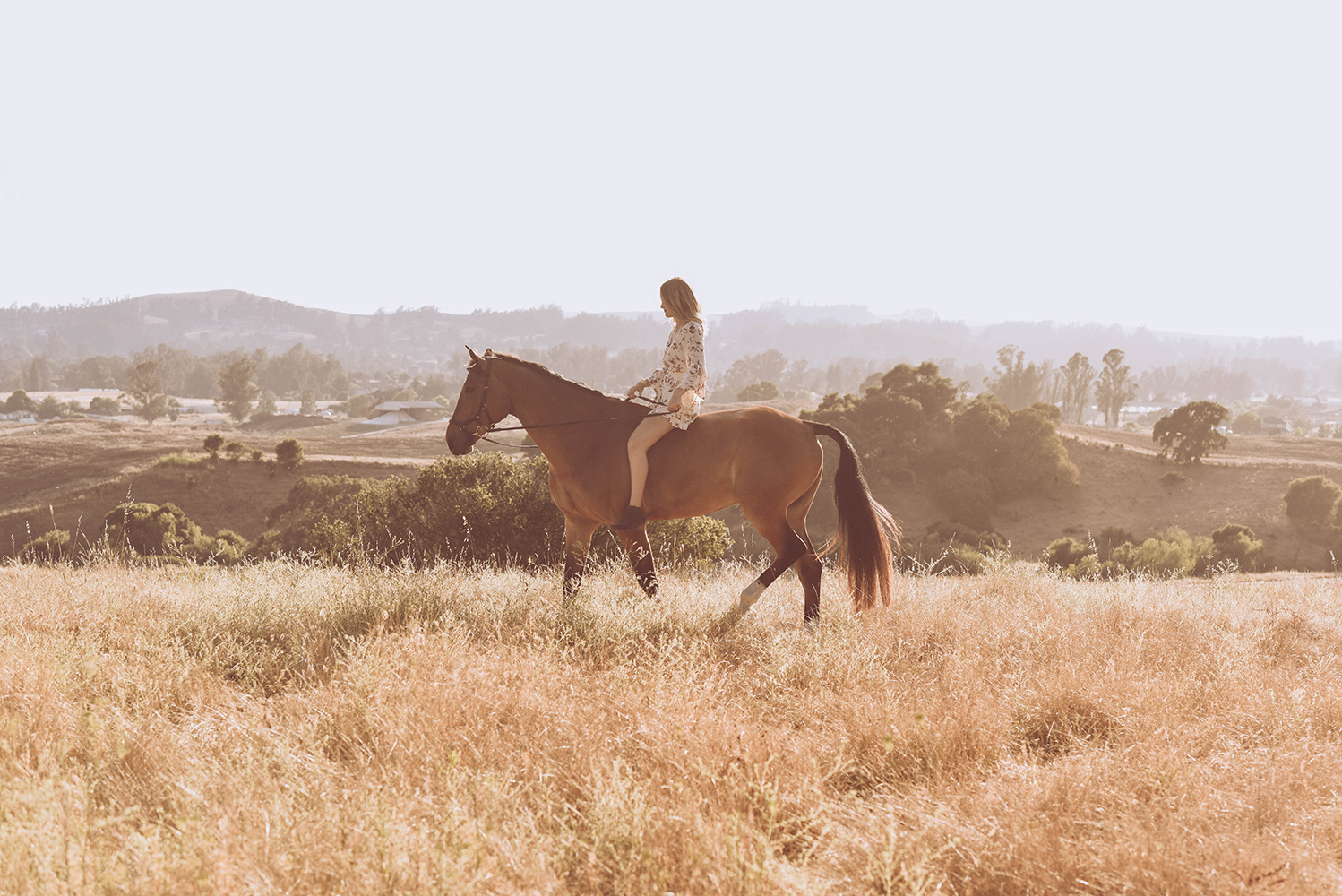 girl riding bareback in a field