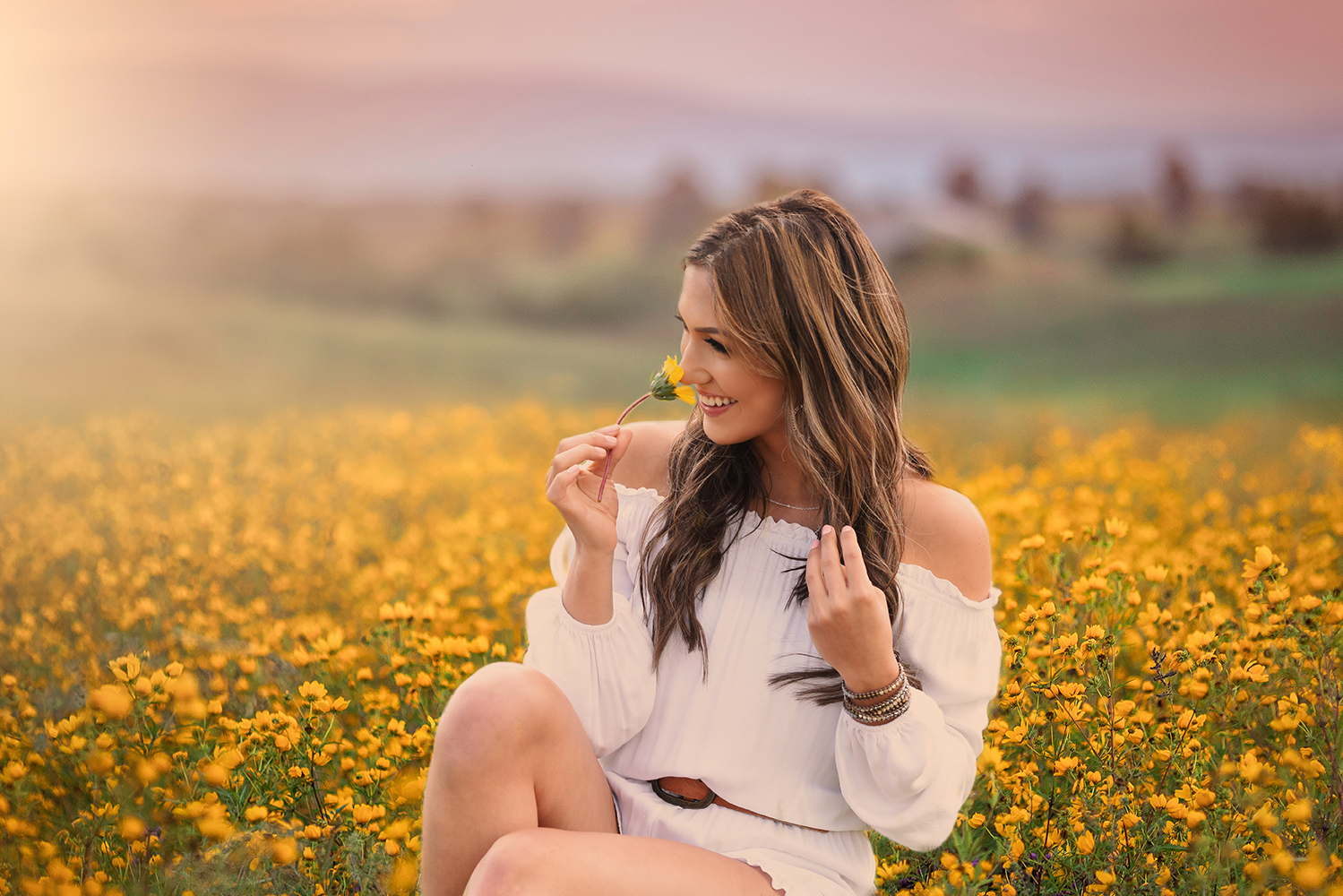 Senior photo of girl in wildflowers