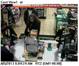 Female Suspect At Cash Register