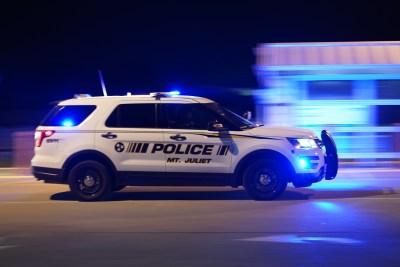 Police SUV Moving w/ Lights