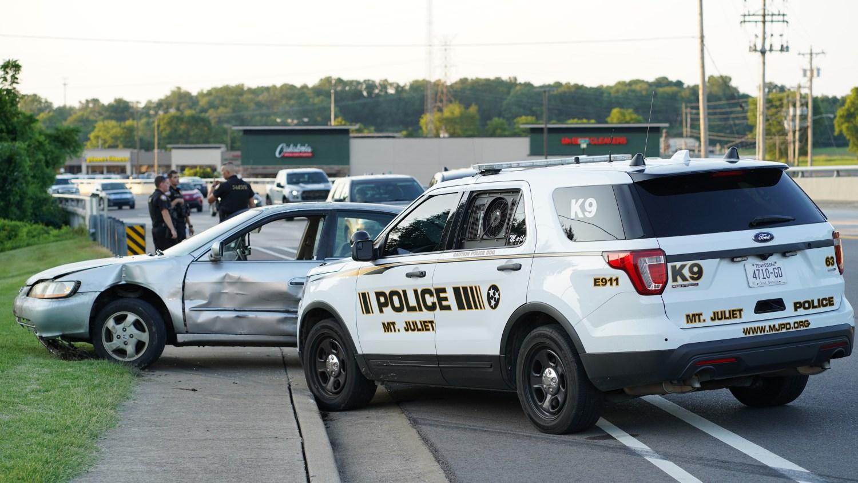 Photo of fleeing vehicle and patrol suv