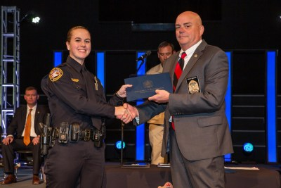 Photo of Officer Megan Smith & TLETA Director Brian Grisham handing her certificate