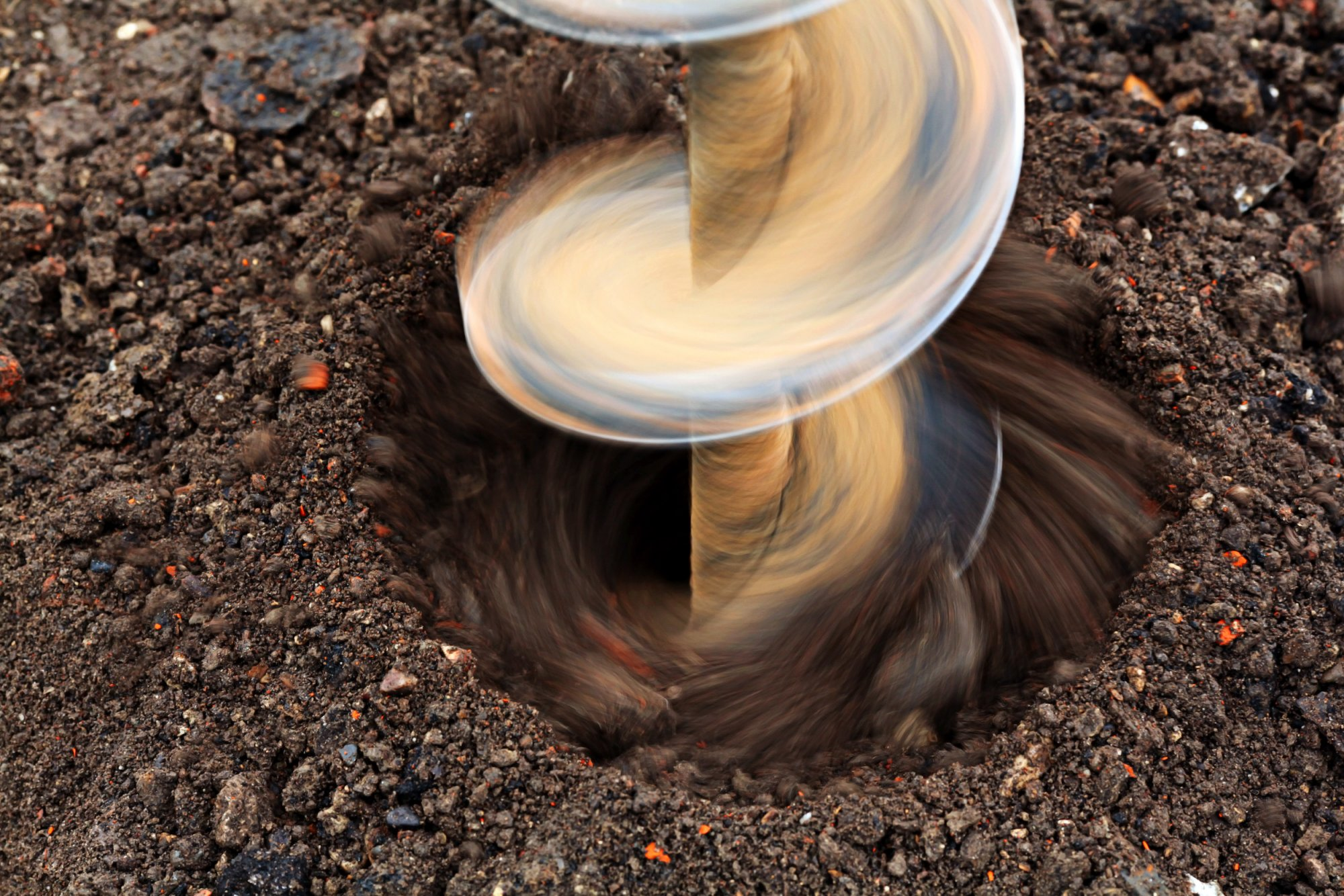 Auger being drilled