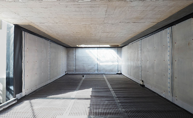 Concrete basement walls and slabs are protected with the appropriate waterproofing membrane system