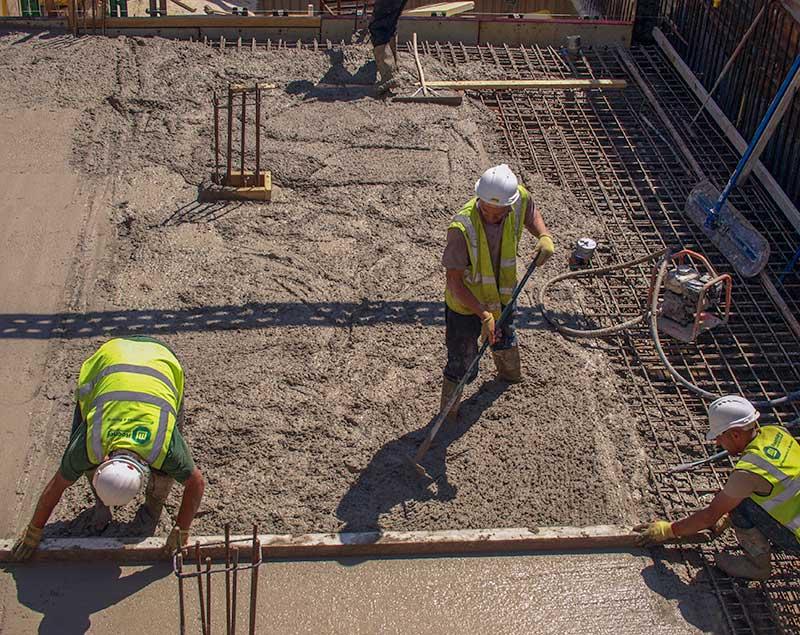 Concrete pumping gang for a basement foundation slab