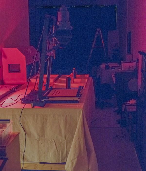 30 day challenge day 8 darkroom enlarger with orange safe lights