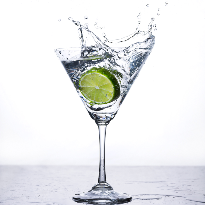 lime wedge splashed into martini glass back lighting with eVolv200 strobes