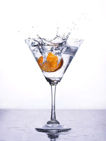 tangerine wedge splashed into martini glass back lighting with eVolv200 strobes