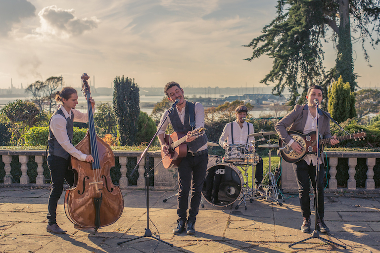 A folk party band performing with a view