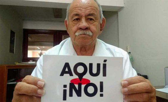 Plant opponent Padilla: 'Not here!' the sign reads.