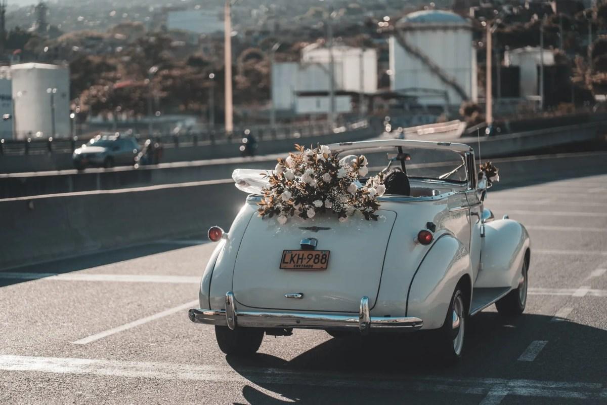 retro wedding cabriolet driving on road