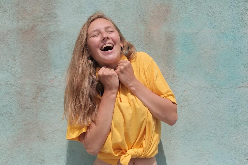 jolly woman in yellow polo shirt