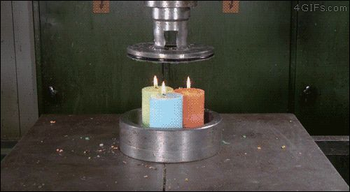 Crushing candles with a hydraulic press.