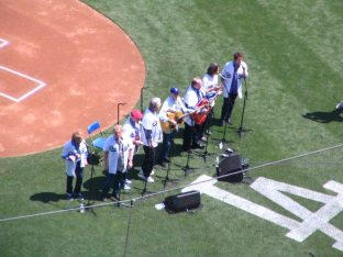 The Beach Boys, pregame, performing Surfer Girl. The Beach Boys also celebrated a 50th anniversary