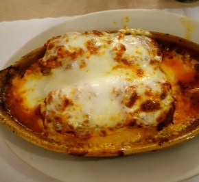Baked lasagna, loaded with meat, cheese and sauce
