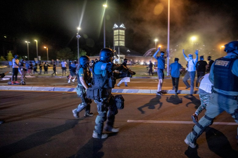 Shelby County Sheriff's deputies use tear gas against protestors.