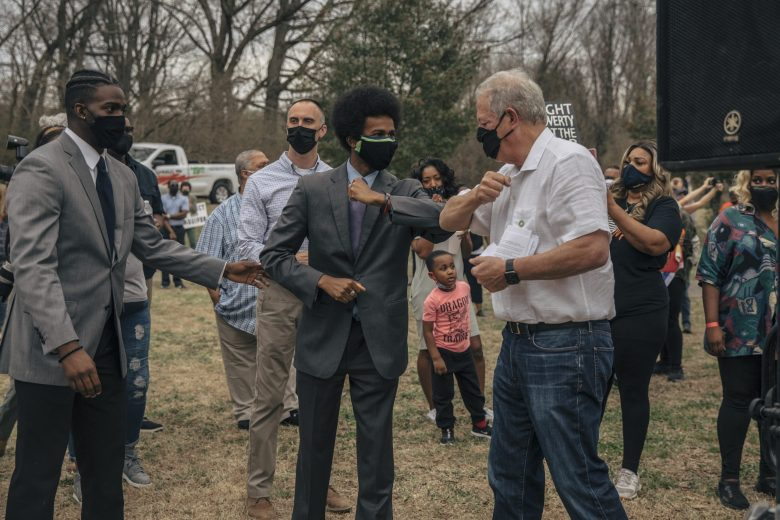 Former Vice President Al Gore bumps elbows with MCAP organizer Justin J. Pearson.