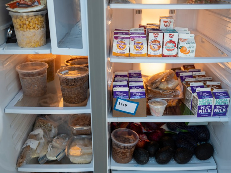 The inside of a stocked community refrigerator.