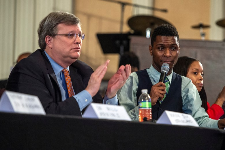 DeVante Hill sits next to Memphis Mayor Jim Strickland at a 2016 community meeting.