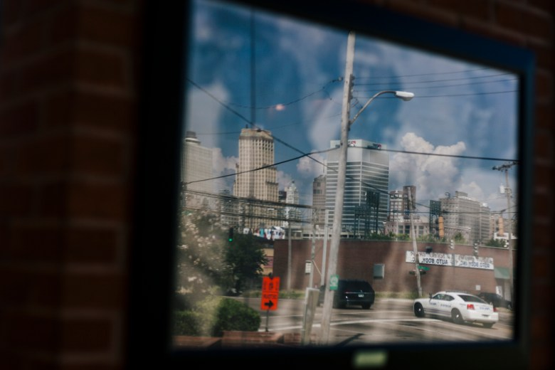 A view of downtown Memphis businesses reflected off the glass of a building.