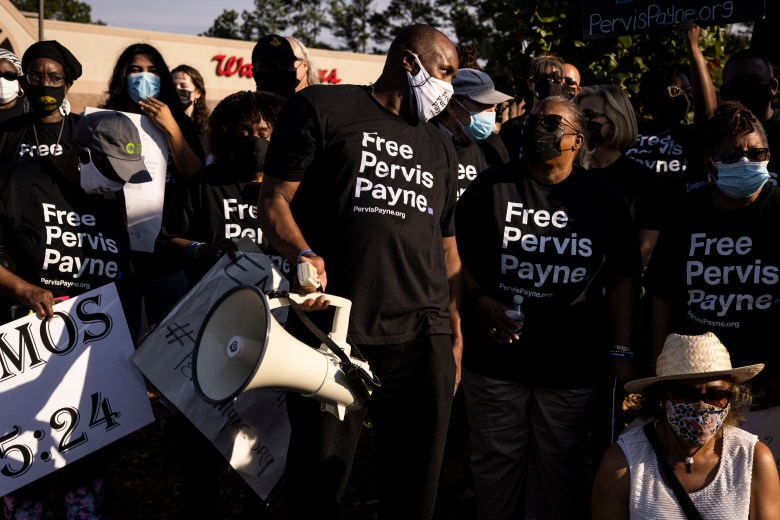 Pervis Payne supporters, wearing Free Pervis Payne t-shirts, demonstrate on the corner of Union and McLean in Memphis.