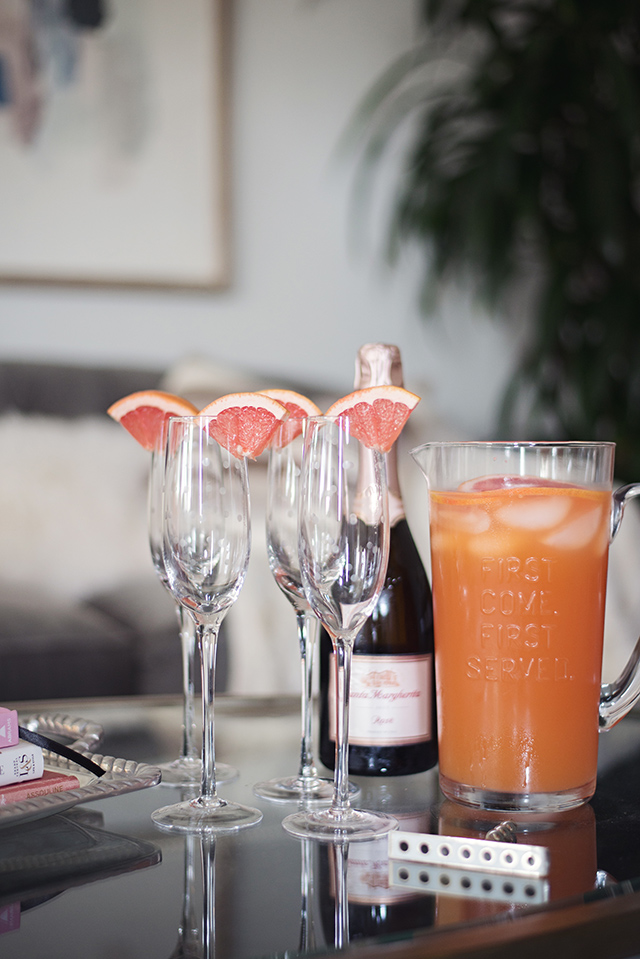 an easy drink idea for a party is to have fresh fruit juice prepared and then top with champagne when guests arrive M Loves M
