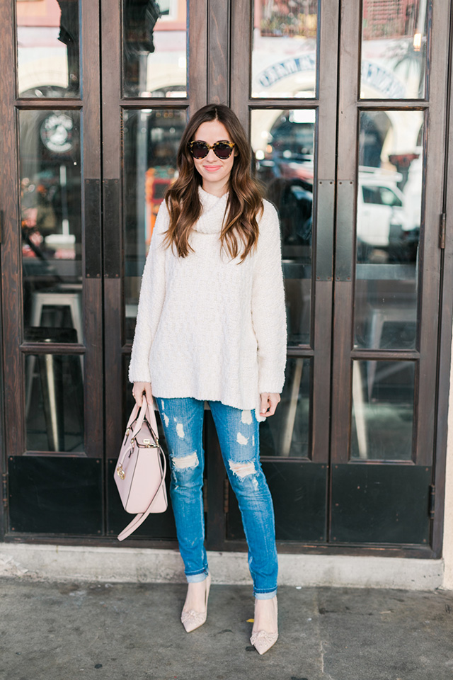 white turtleneck sweater with distressed jeans and heels M Loves M