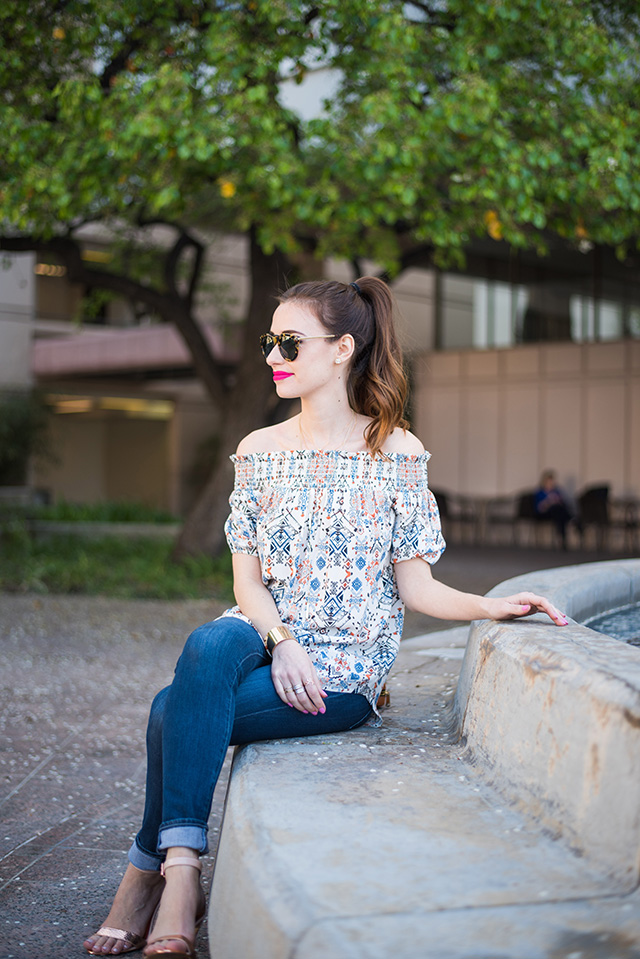 casual outfit for spring with a printed off the shoulder top and jeans M Loves M
