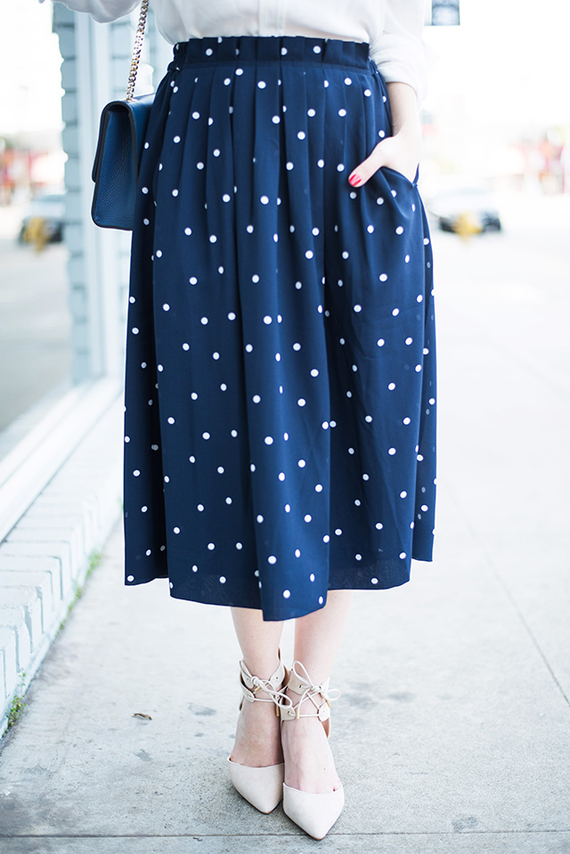 navy polka dotted skirt with nude suede heels from sole society