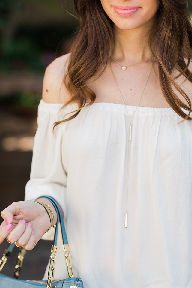 pair an off the shoulder top with a long pendant necklace