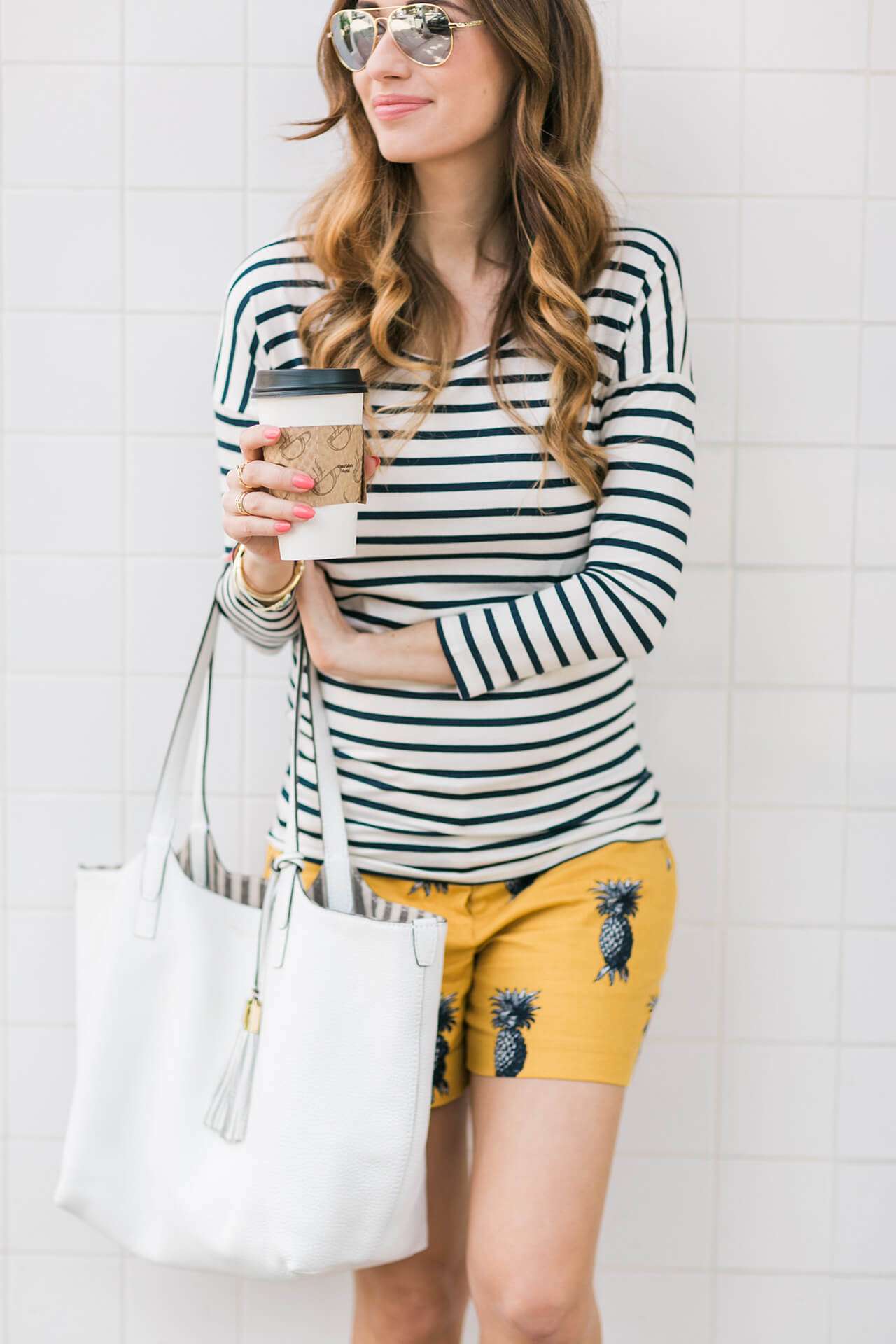 striped top with pineapple shorts outfit